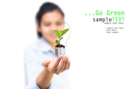 green bulb: Girl and green tree light bulbs, Symbol of go green concept