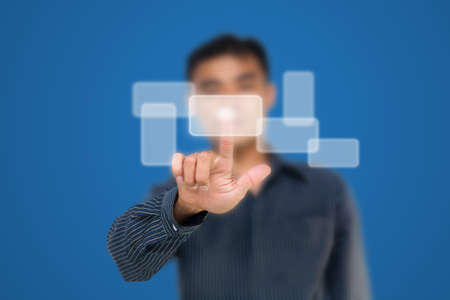 Business man pushing white touch screen photo