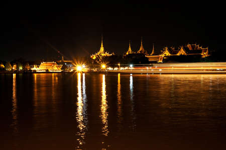 Abstract light against beautiful temple beside a river, Thailand photo