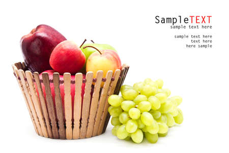 Apple fruit in basket and green grape beside, isolate on white photo