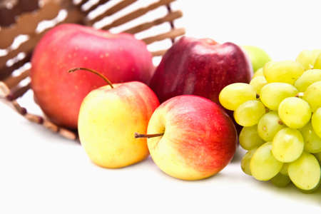 Apple and grape fruit isolate on white photo
