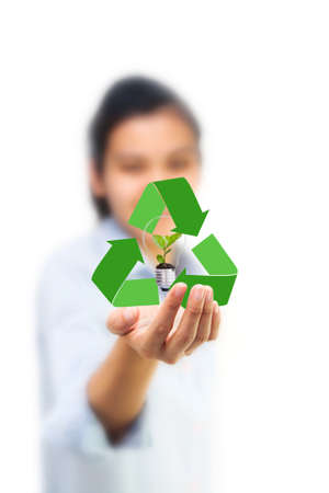 Girl's hand holding recycling and green tree Stock Photo - 11216523