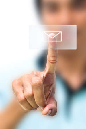 high key: Man pushing email icon on touch screen pad