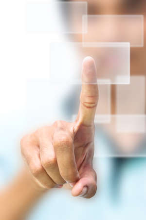 Business man pushing on touch screen icon photo
