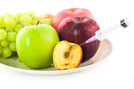 syring: Syring injected into an apple fruit Stock Photo