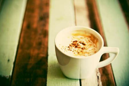 Grunge coffee cup on wooden table Stock Photo