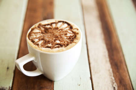 Cup of coffee on wooden table Stock Photo - 14183736