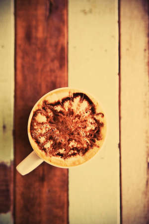 Cup of coffee on wooden table vintage Stock Photo - 14184069