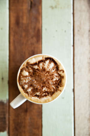 Cup of coffee on grunge wooden floor Stock Photo - 14183949