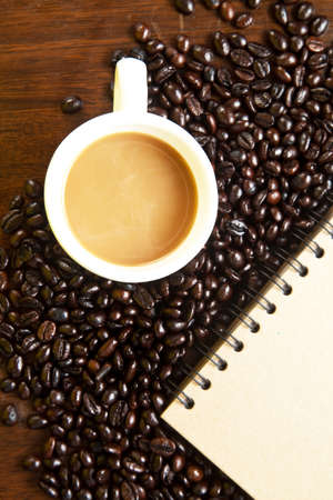 cofffee: Cofffee cup and beans with book