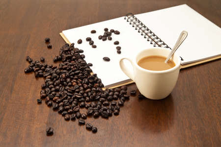coffeebeans: Cup of coffee and beans with white book