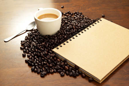 blackness: Cup of coffee and book