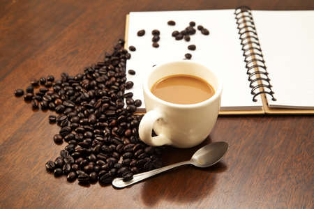 coffeebeans: Cup of coffee and beans with book