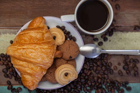 milk and cookies: Cookies with croissant and coffee beans