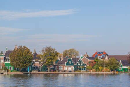 netherland: Colourful houses with dutch windmill in Zaaneschans, Netherland