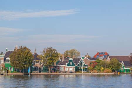 zaan: Colourful houses with dutch windmill in Zaaneschans, Netherland