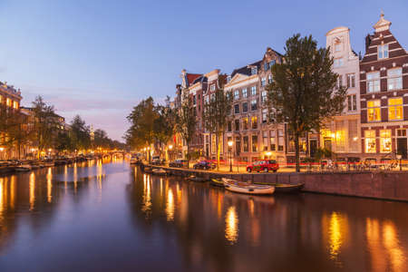 Beautiful authentic dutch with canal of Amsterdams at twilight night