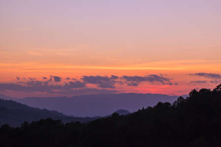 Tropical sunset background against Doi Luang, Thailand Stock Photo