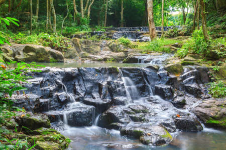 khamin: Beatiful of waterfall in national green forest background