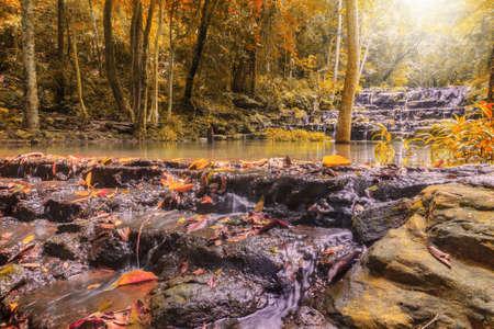 Beatiful of waterfall in colorful autumn forest with sun ray, Saraburi, Thailand