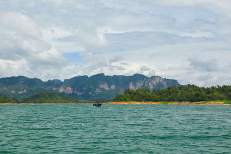 Beautiful mountains lake and natural attractions in Ratchaprapha Dam at Khao Sok National Park, Thailand