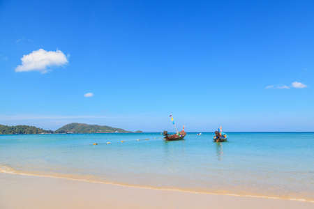 Long tail boats at the beautiful beach in Phuket, Thailand