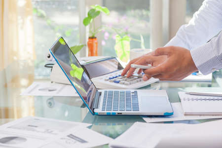 Business man pointing on laptop monitor during working at home office