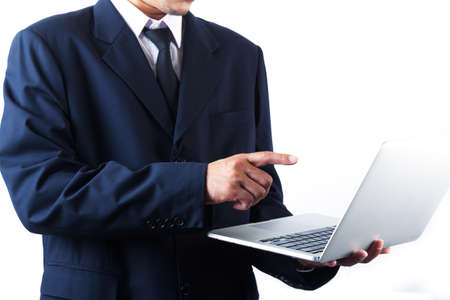 Business man holding laptop and pointing on screen Imagens