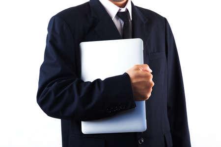 Business man holding laptop isolated on white background