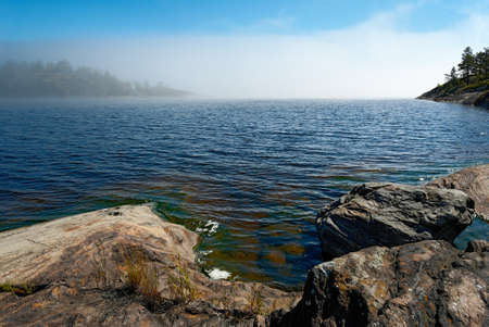 Fog on a sunny day. Lake Ladoga Stock Photo