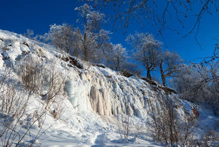 Winter landscape. Steep cliff. Ice