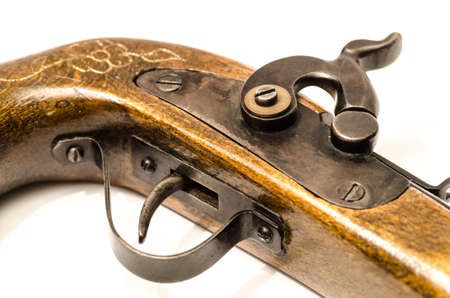 old wooden gun isolated on white background photo