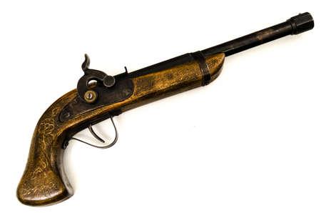 白い背景上に分離されて古い木製の銃