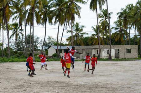 ZANZIBAR, TANZANIA - MARCH 26 2013: local african soccer team during training on sand playing field Editorial