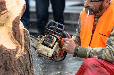 KIEV, UKRAINE, 2 JANUARY 2014: artist carving wood with chainsaw during euromaidan in ukraine