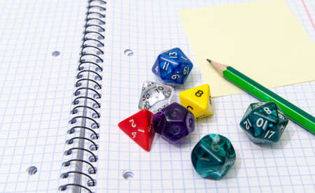 role playing: role playing dices lying on exercise book Stock Photo