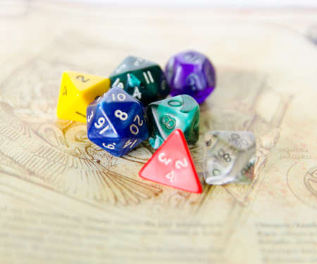 dungeons: role playing dices lying on picture background - stock photo