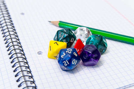 set of open exercise book, pencil and dices - stock photo Stock Photo