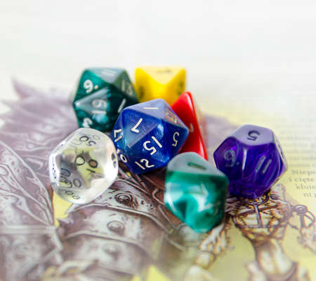 role playing: role playing dices lying on picture background - stock photo