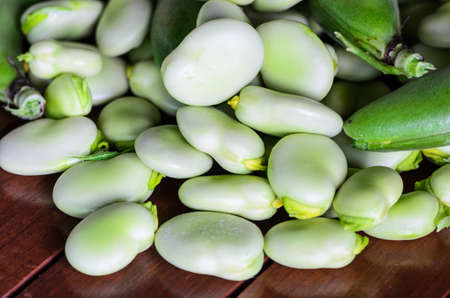 bakla: closeup of broad bean on wooden table - stock photo