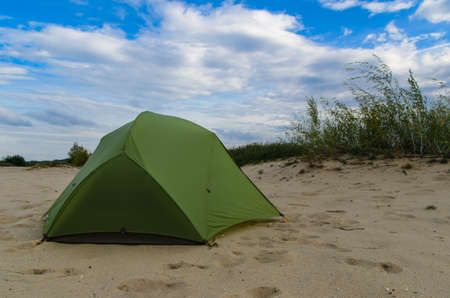 pitched tent in the desert on sunny day  photo