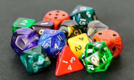 dungeons: role playing dices lying on black background - stock photo