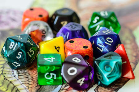 rpg: role playing dices lying on picture background
