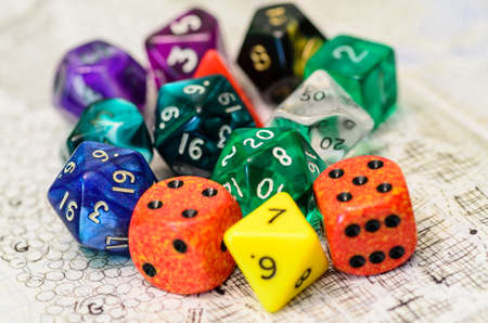 role playing: role playing dices lying on sketch map
