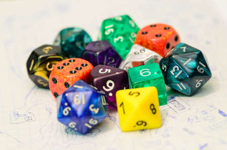 role playing: role playing dices lying on sketch map - stock photo