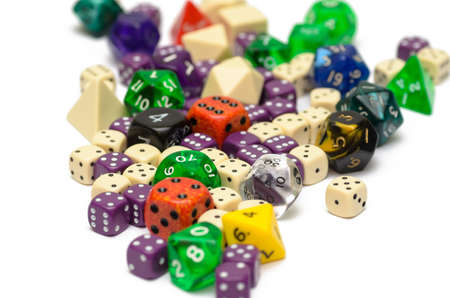 role playing: multiple colorful role playing dices lying on isolated background - stock photo