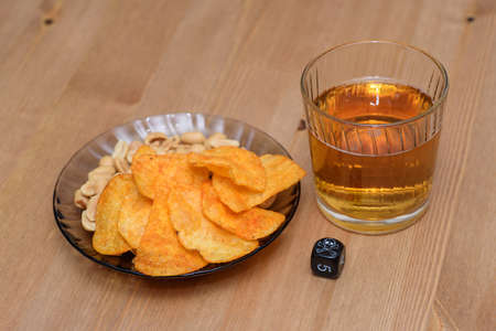 unhealthy snacks on table with skull dice photo