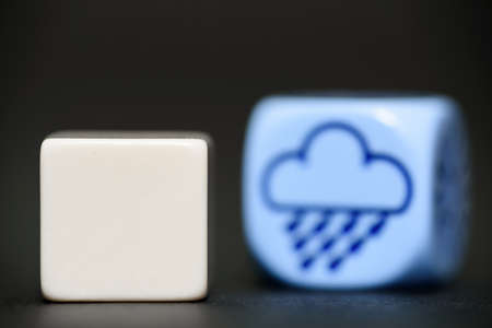 blank dice with weather dice (rain) in background  Stock Photo