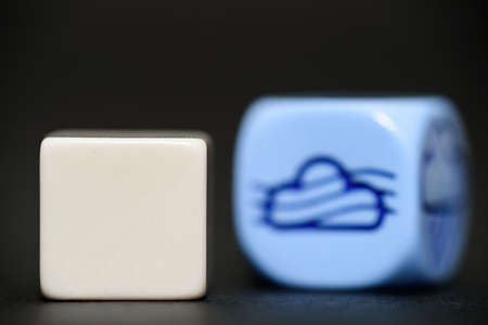 randomness: blank dice with weather dice (fog) in background
