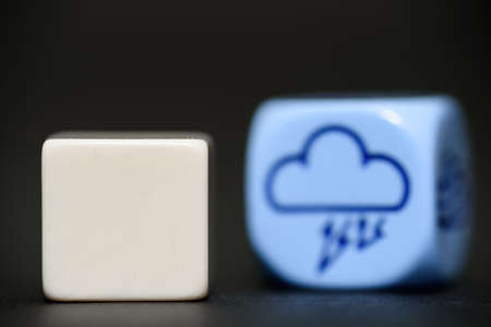 randomness: blank dice with weather dice  Stock Photo